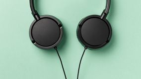 Close-up black headphone. Music concept stock photography