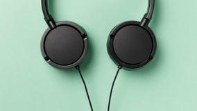 Close-up black headphone. Music concept stock photography