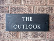 Close up of black house sign the outlook on brick wall Stock Photo