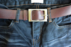 Close up black jeans trouser and brown leather belt. Royalty Free Stock Images