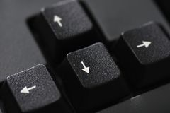 Closeup of a black keyboard arrow button stock photos