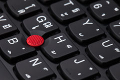 Close up of a black keyboard english and thai alphabet Stock Photos