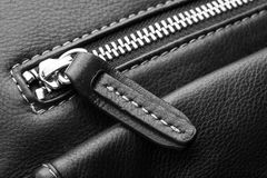 Close up of black leather bag zipper Royalty Free Stock Images