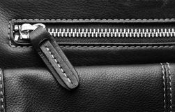 Close up of black leather bag zipper Stock Photos