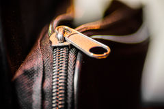 Close up of black leather bag zipper Stock Image
