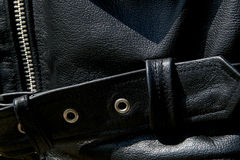 Close up of black leather biker jacket belt Royalty Free Stock Images