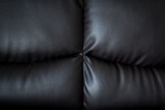 Close up black leather sofa and textured and background Royalty Free Stock Photography