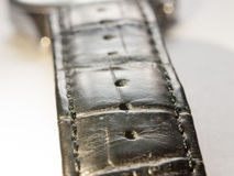Close up of black leather strap for watch on a white background Royalty Free Stock Photography