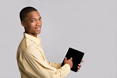 Close up of Black Man Hand Pointing to Tablet PC Royalty Free Stock Photography