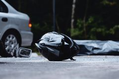 Close-up of black motorcycle helmet. Inattentive car driver on the road with motorcyclist Royalty Free Stock Images