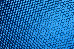Close up of black net. Blue light. Stock Photography