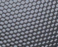 Close up of black net. Gray light. Stock Image