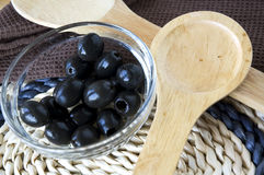 Close up black olives with spoon Stock Photos