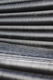 Close up of black plastic pipes with diminishing perspective Royalty Free Stock Images