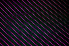 Black fabric texture. A close up of a Black with purple lines stitching Stock Photo