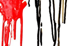 Black and red paint. Close-up of the black and red flowing paint isolated on white background royalty free stock photography