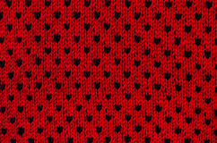 Close up on black and red heart dots woolen texture. Royalty Free Stock Photo