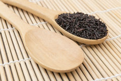 Close up Black rice berry on wooden spoon Royalty Free Stock Images