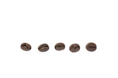 Close up black roasted coffee bean isolated on white Royalty Free Stock Photo