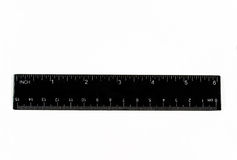 Close-up of a black ruler. (isolated on white Stock Photography