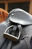 Close up of black saddle on horse back Royalty Free Stock Image