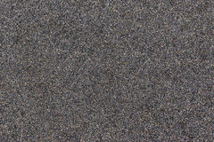 Close up of black sand texture with coloured flecks Royalty Free Stock Photography