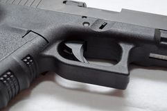 A close up of a black semi automatic pistol Stock Image