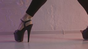 Close up for black shoes for pole dance with high heels on legs of a woman-dancer, modern dance concept. Action. A woman. Close up for black shoes for pole dance stock photo