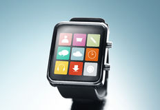 Close up of black smart watch with app icons Stock Photography