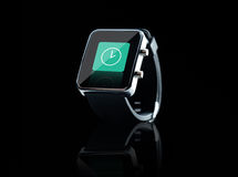 Close up of black smart watch with clock icon Stock Images