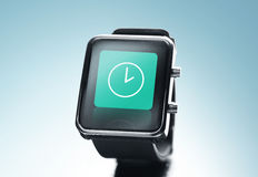 Close up of black smart watch with clock icon Royalty Free Stock Images