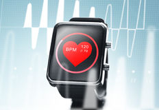 Close up of black smart watch with heart beat icon Stock Photos