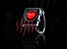 Close up of black smart watch with heart beat icon. Modern technology, object, health care and media concept - close up of black smart watch showing red heart Stock Photo