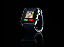 Close up of black smart watch with incoming call. Modern technology, communication, object and media concept - close up of black smart watch with incoming call stock images