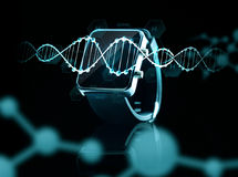 Close up of black smart watch over dna molecules Royalty Free Stock Photography