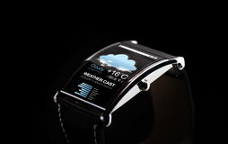 Close up of black smart watch with weather cast Stock Photography
