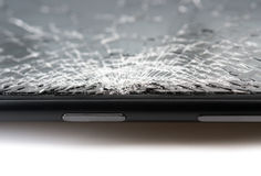 Close up of black smartphone with broken screen. Close up of a black smartphone with broken screen Royalty Free Stock Image