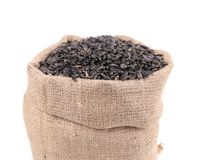 Close up of black sunflower seeds in bag. Royalty Free Stock Images