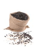 Close up of black sunflower seeds in bag. Stock Photos