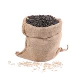 Close up of black sunflower seeds in bag. Stock Photo