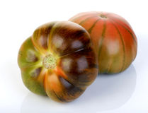 Close up of black tomatoes Stock Images