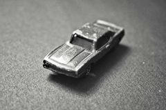 Close up of Black and white destroyed toy car. royalty free stock photography