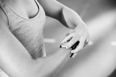 Close up black and white image of a female athlete adjusting her Royalty Free Stock Photos