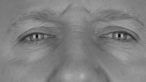 Close-up in black and white on  man's eyes, angry stock video footage