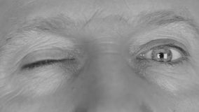 Close-up in black and white on  man's eyes stock footage