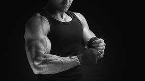 Close-up black and white photo of power athlete wrapping hands w Royalty Free Stock Photo