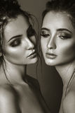 Close-up black and white portrait of two beautiful women. Glamou Stock Photos