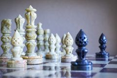 Close-up of chess pieces on chessboard Royalty Free Stock Photo