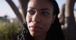 Close up of Black woman with sun shining on her face Stock Photos