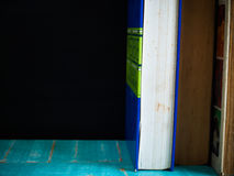 Close up Blackboard and  books. Close up Blackboard and  books , on the table in the classroom Royalty Free Stock Image